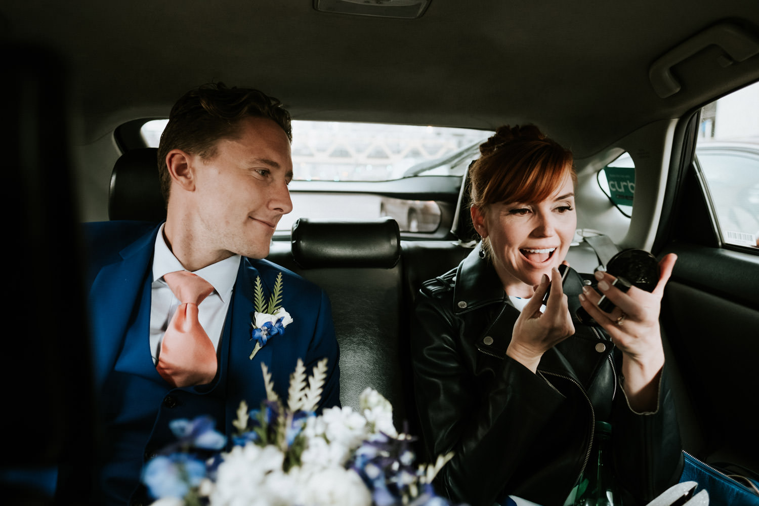 bride fixes her make up on the way to the portrait session. Photograph taken on elopement day