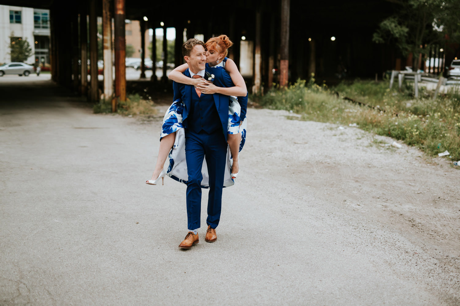 Groom carries the bride during their elopement in Chicago