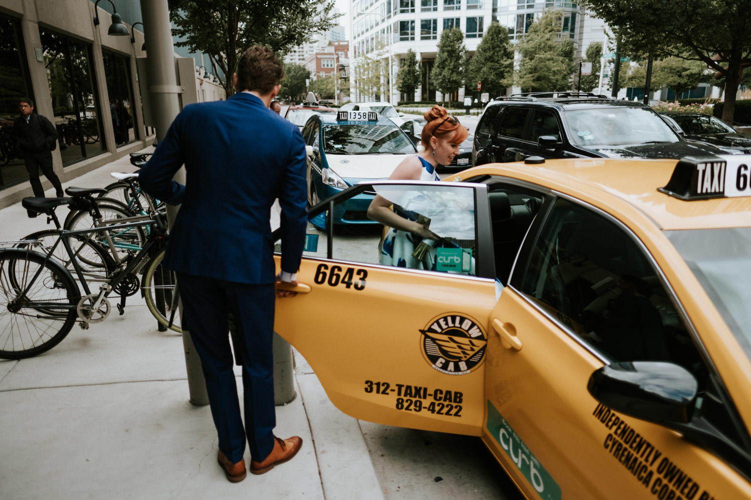 bride and groom take a cab during the elopement day in Chicago