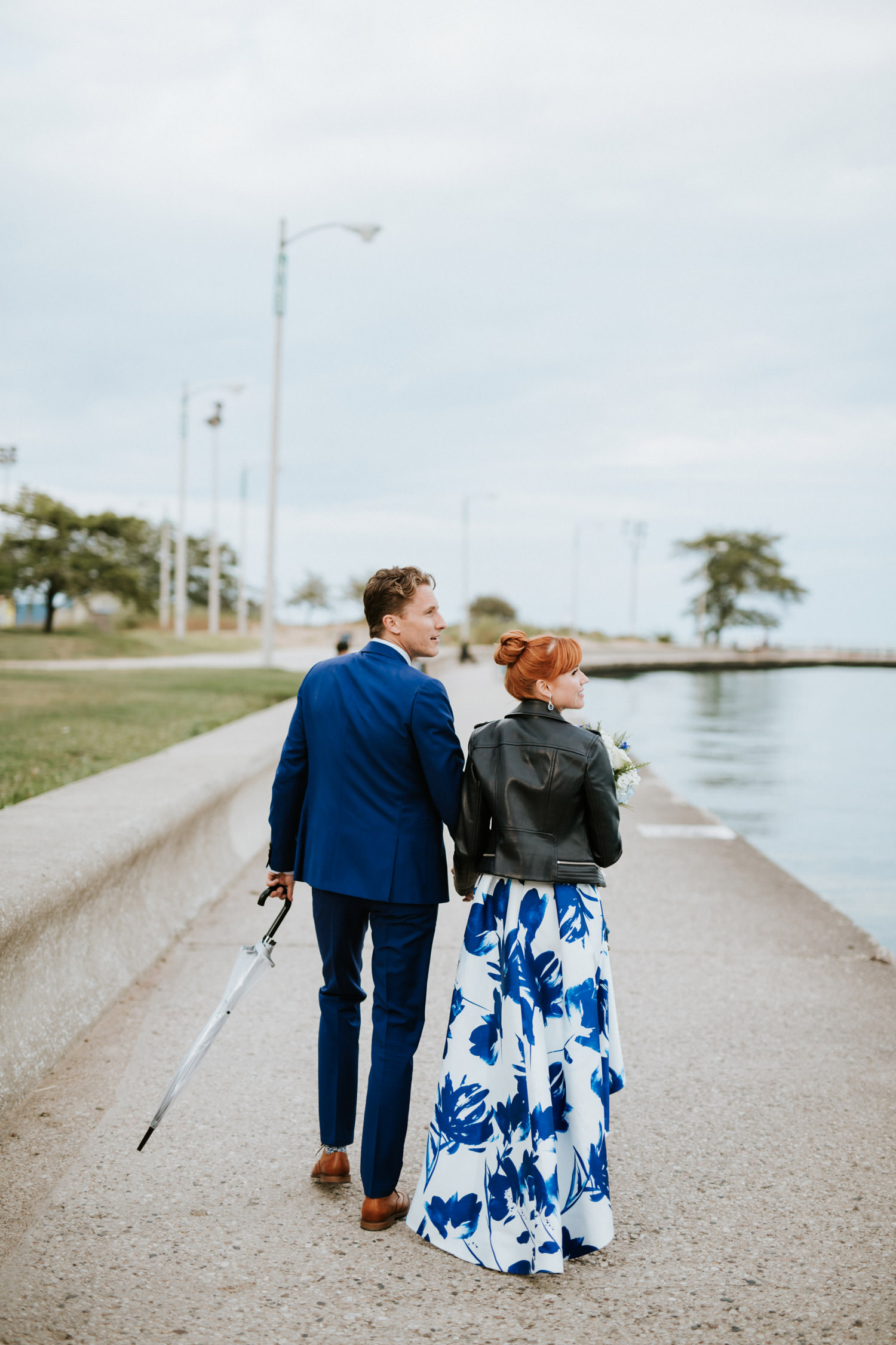 bride and groom walk by the lake michigan at North Ave Beach during their elopement