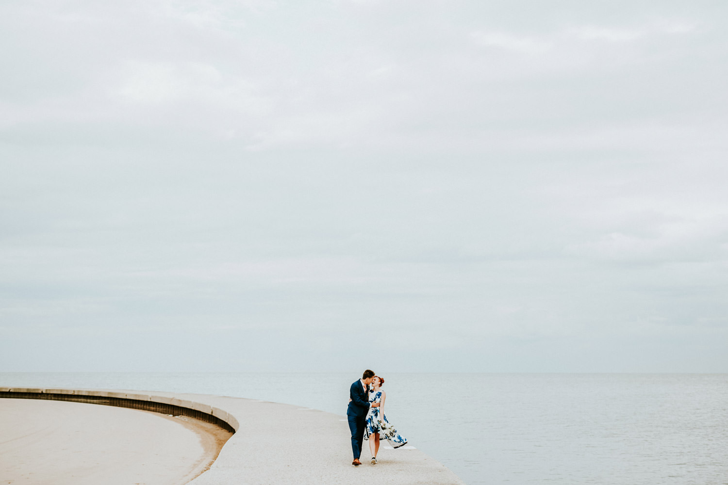 Chicago elopement photographer. Bride and groom captured at North Beach during their elopement day