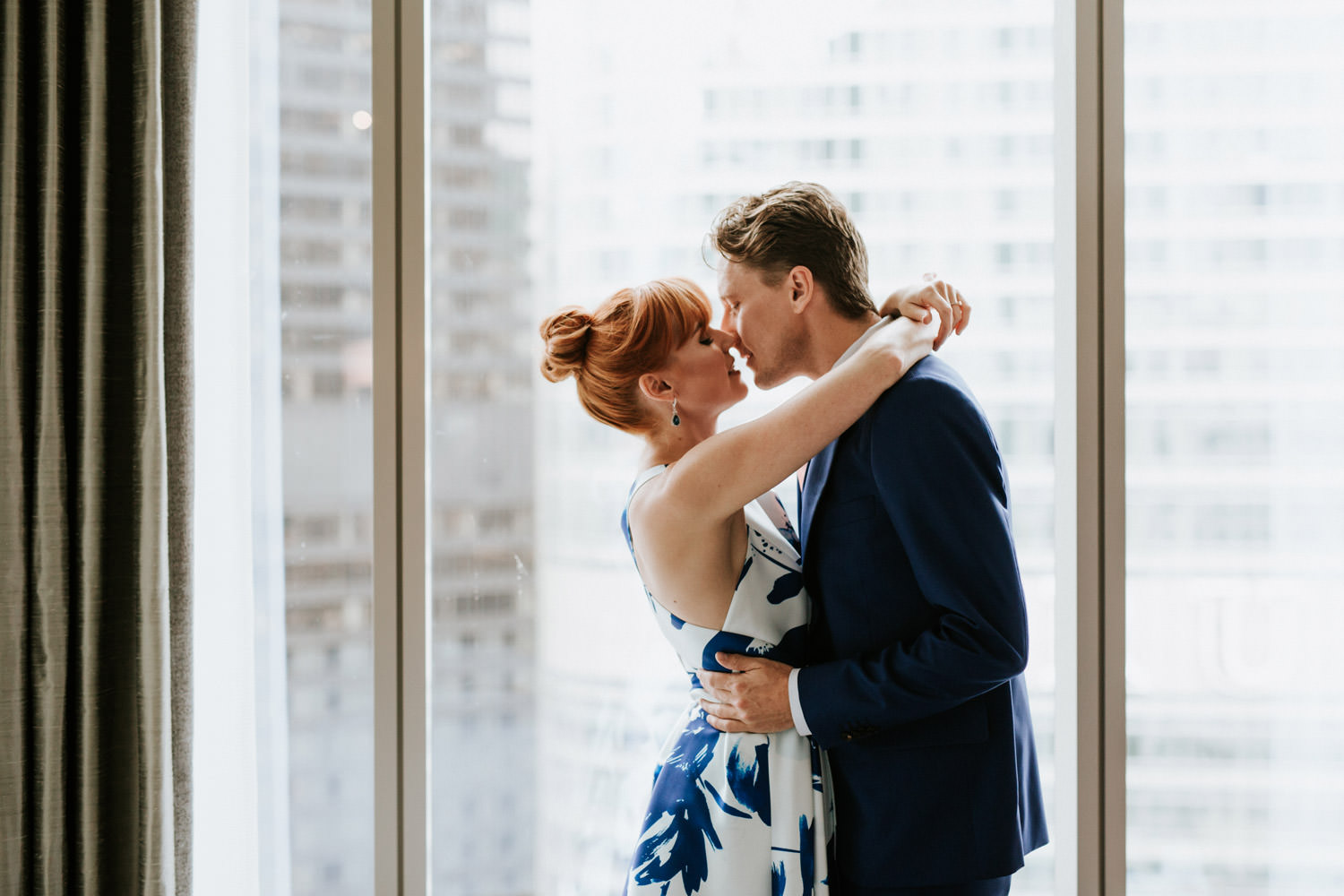 Bride and groom kiss at London House in Chicago during their elopement day.