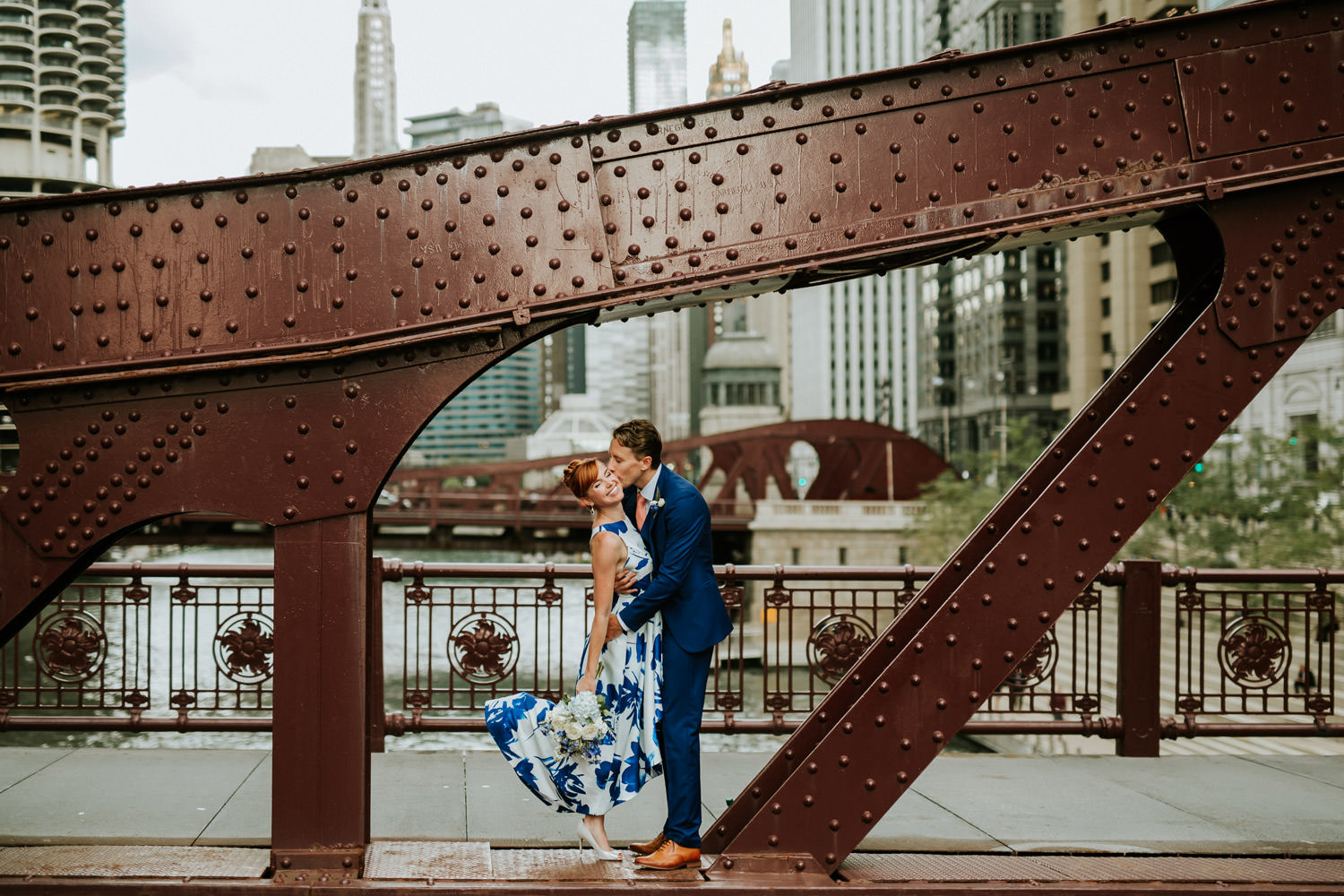 Chicago elopement photographer captures the portrait of the bride and groom in downtown