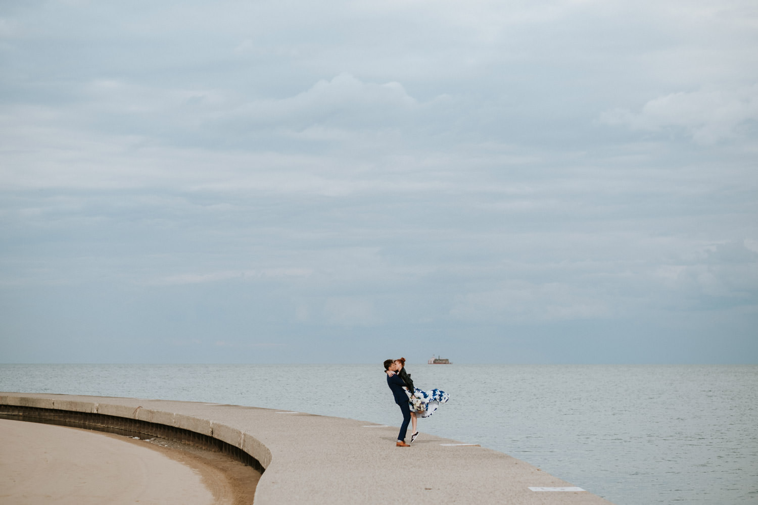 a photograph of a bride and groom taken at lake michigan during their Chicago elopement