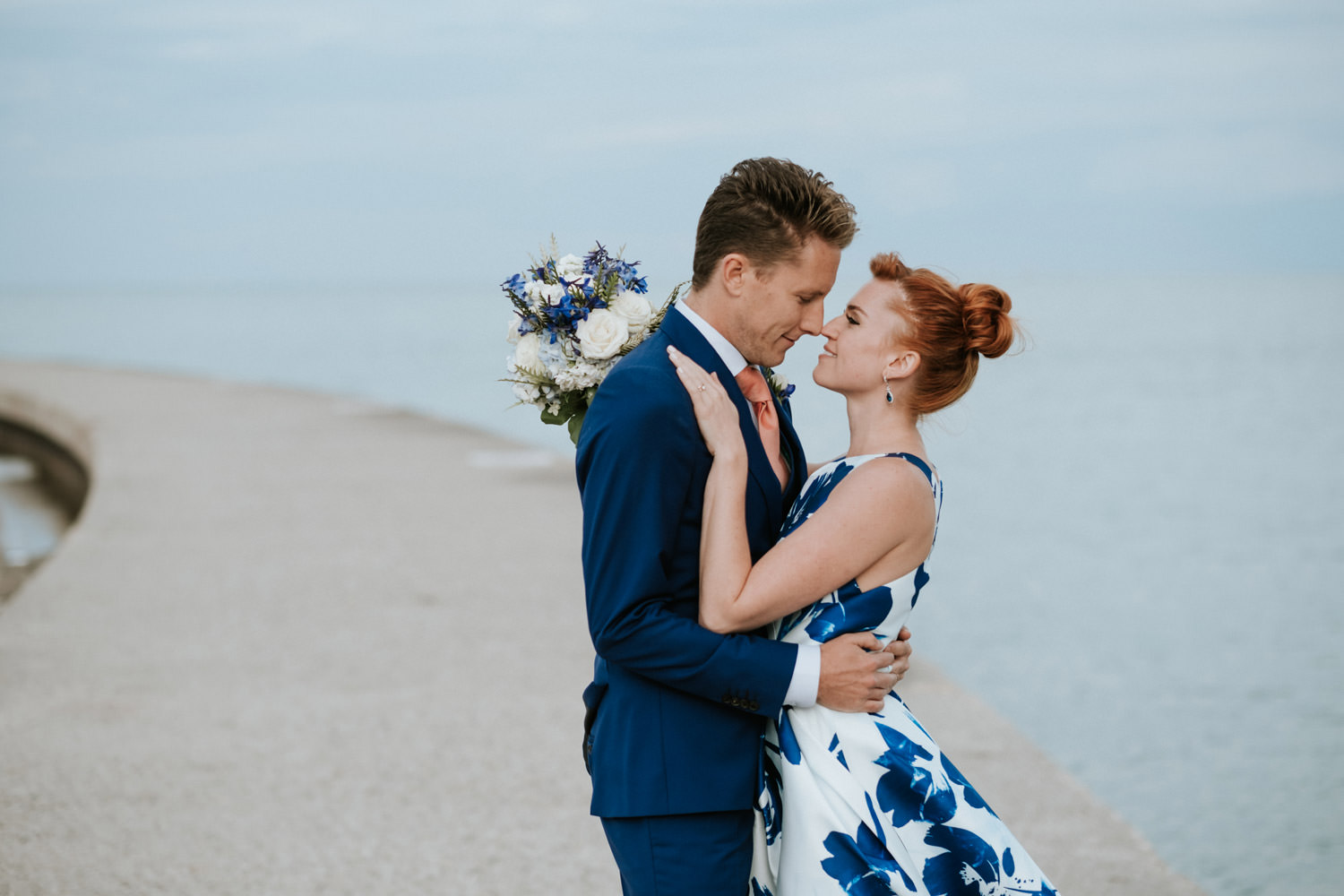 intimate moment between bride and groom captured byt the lake. The photo taken during their Chicago elopement