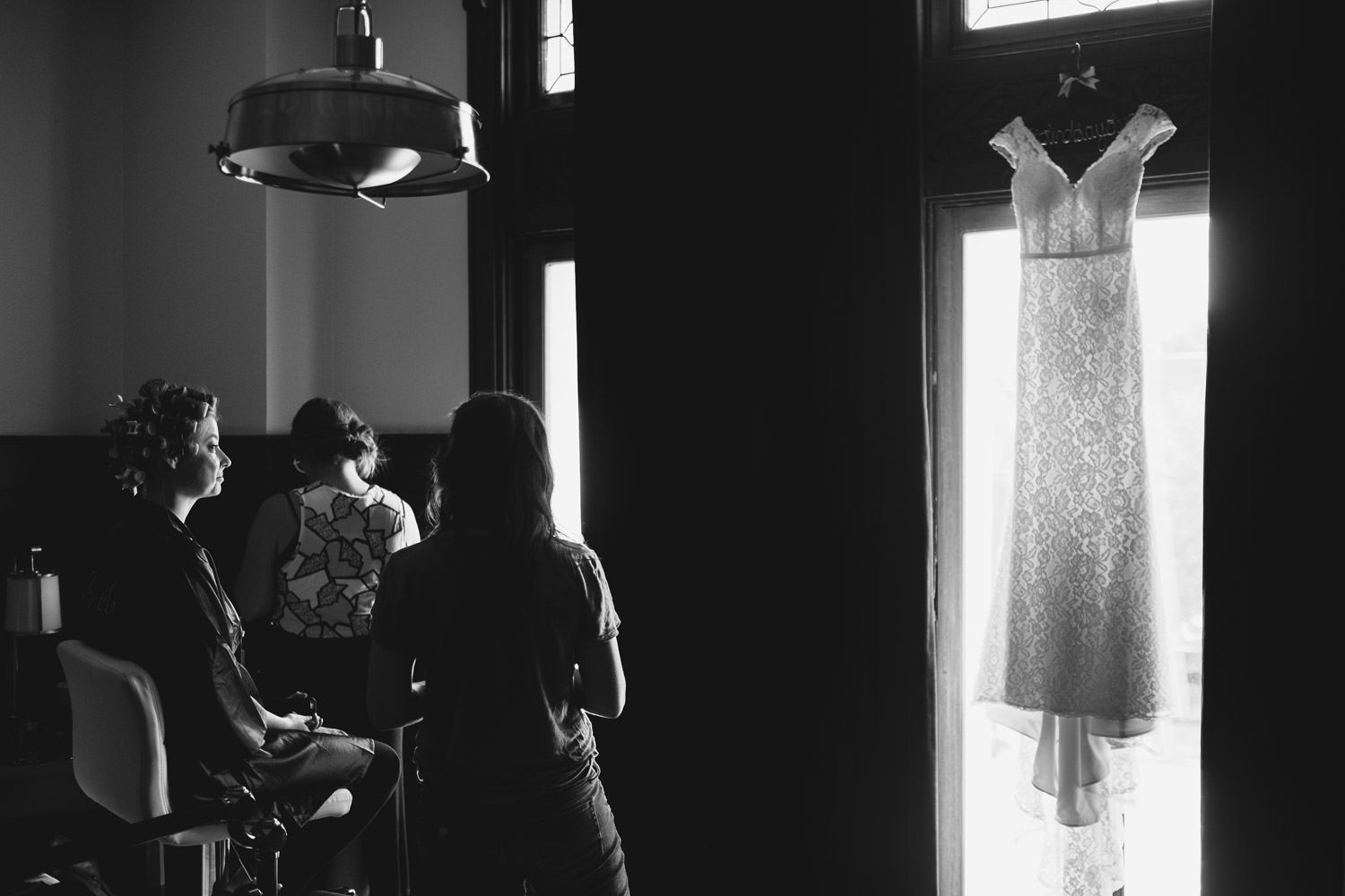 bride looking out the window during the wedding day at Chicago Athletic Association