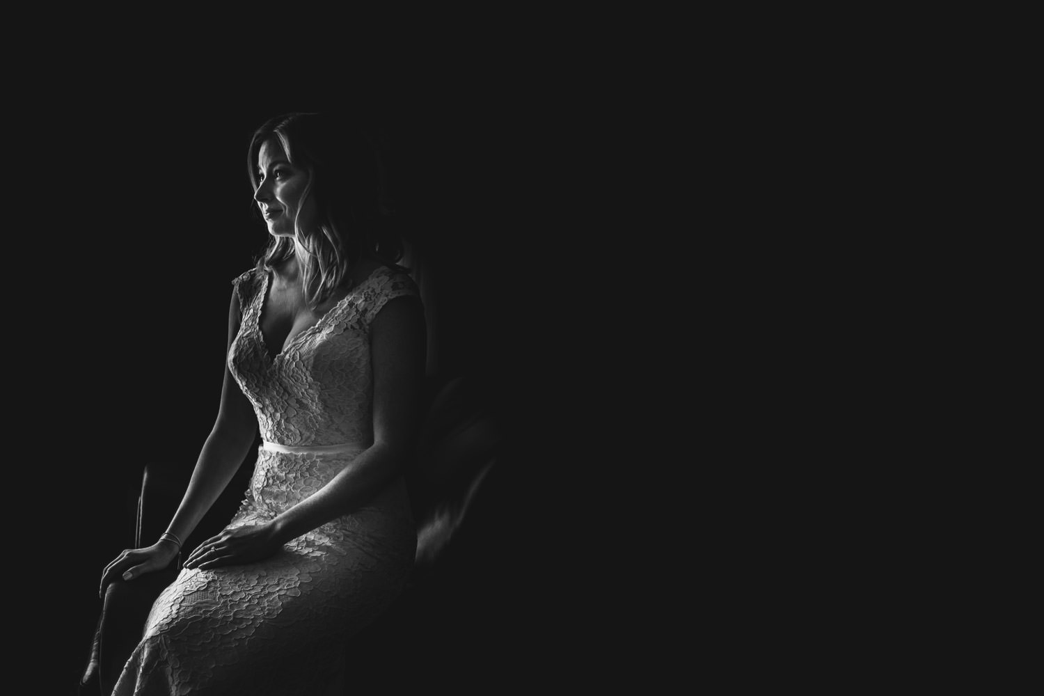 moody photo of the bride taken at Chicago Athletic Association hotel during the wedding