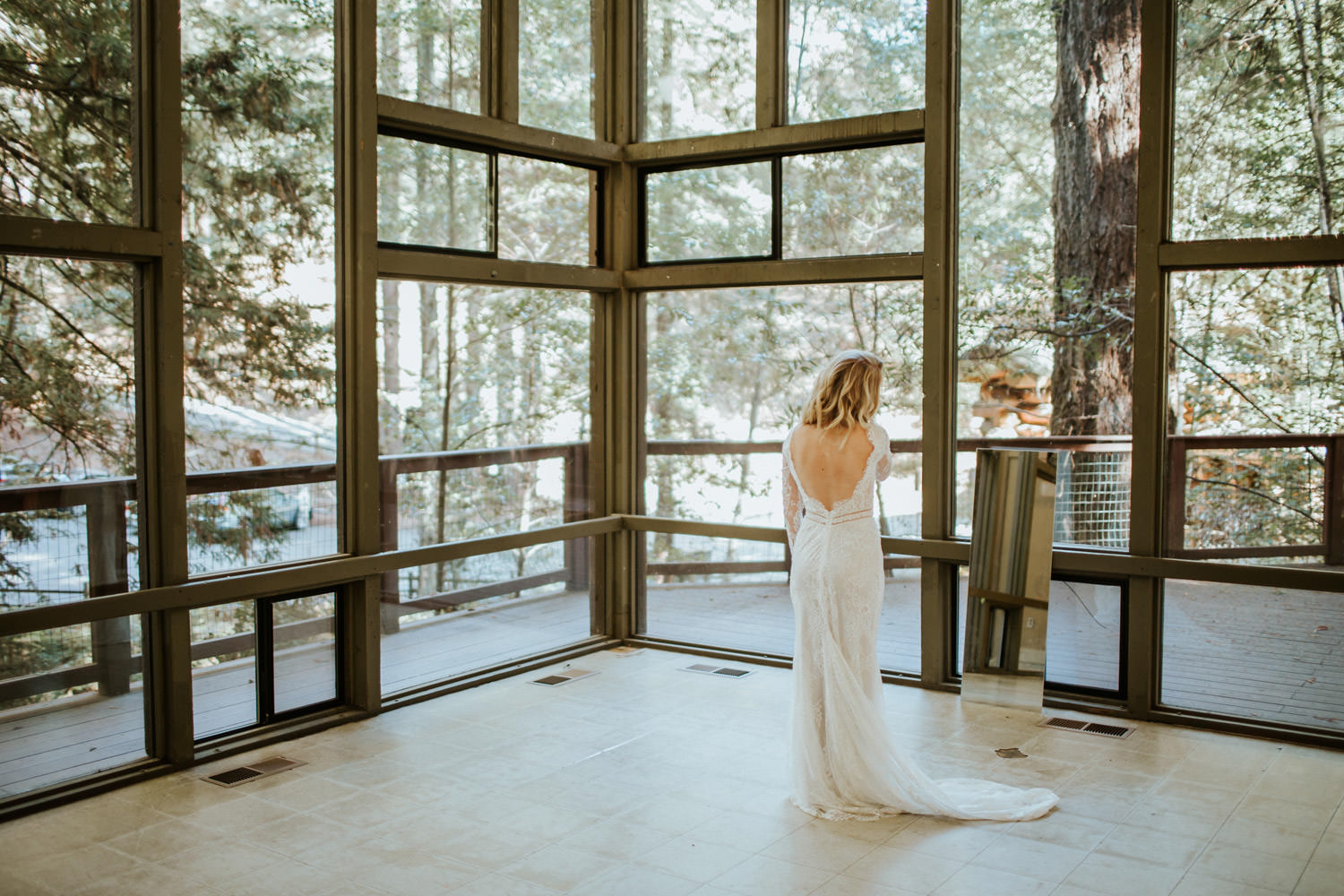 Bride putting on her wedding dress in Camp Campbell in California
