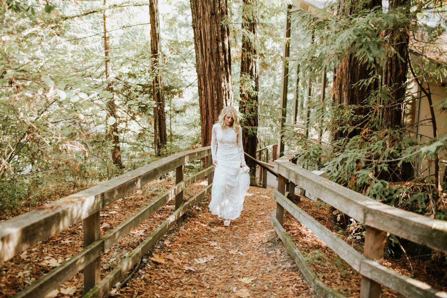 bride walking the trails at YMCA Camp Campbell on the wedding day