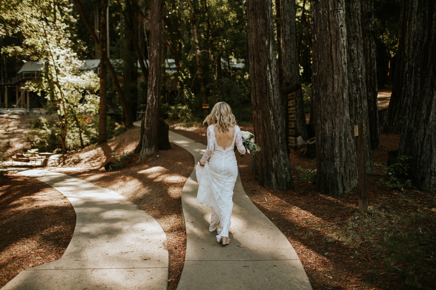 Bride walking to see the groom for the first time at YMCA Camp Campbell