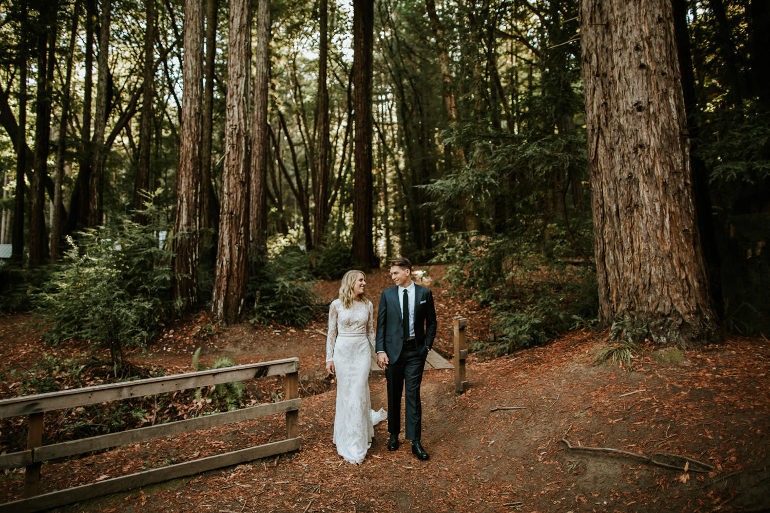 Bride and groom explore the trails of YMCA Camp Campbell during their wedding day