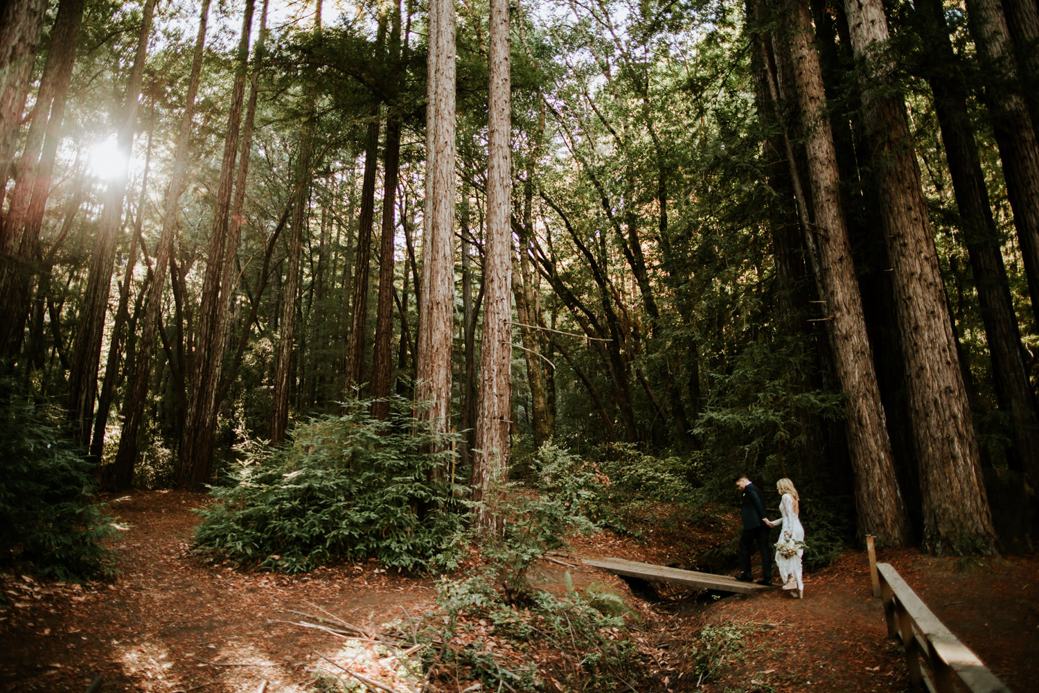 Bride and groom walking the trails of Camp Campbell in California