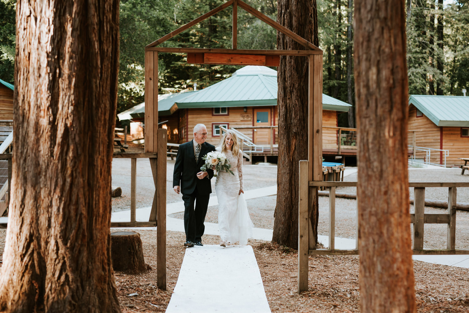 Father and bride enter the chapel at YMCA Camp Campbell