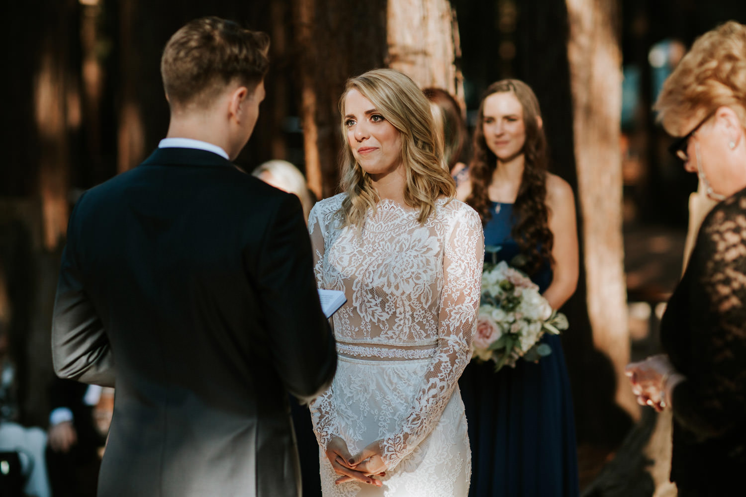 Picture of the bride looking at the groom during exchange of the vows at YMCA Camp Campbell