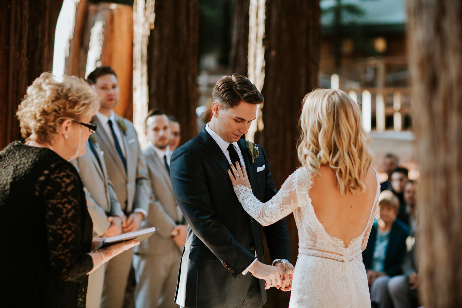Bride touches her groom softly during the wedding at YMCA Camp Campbell