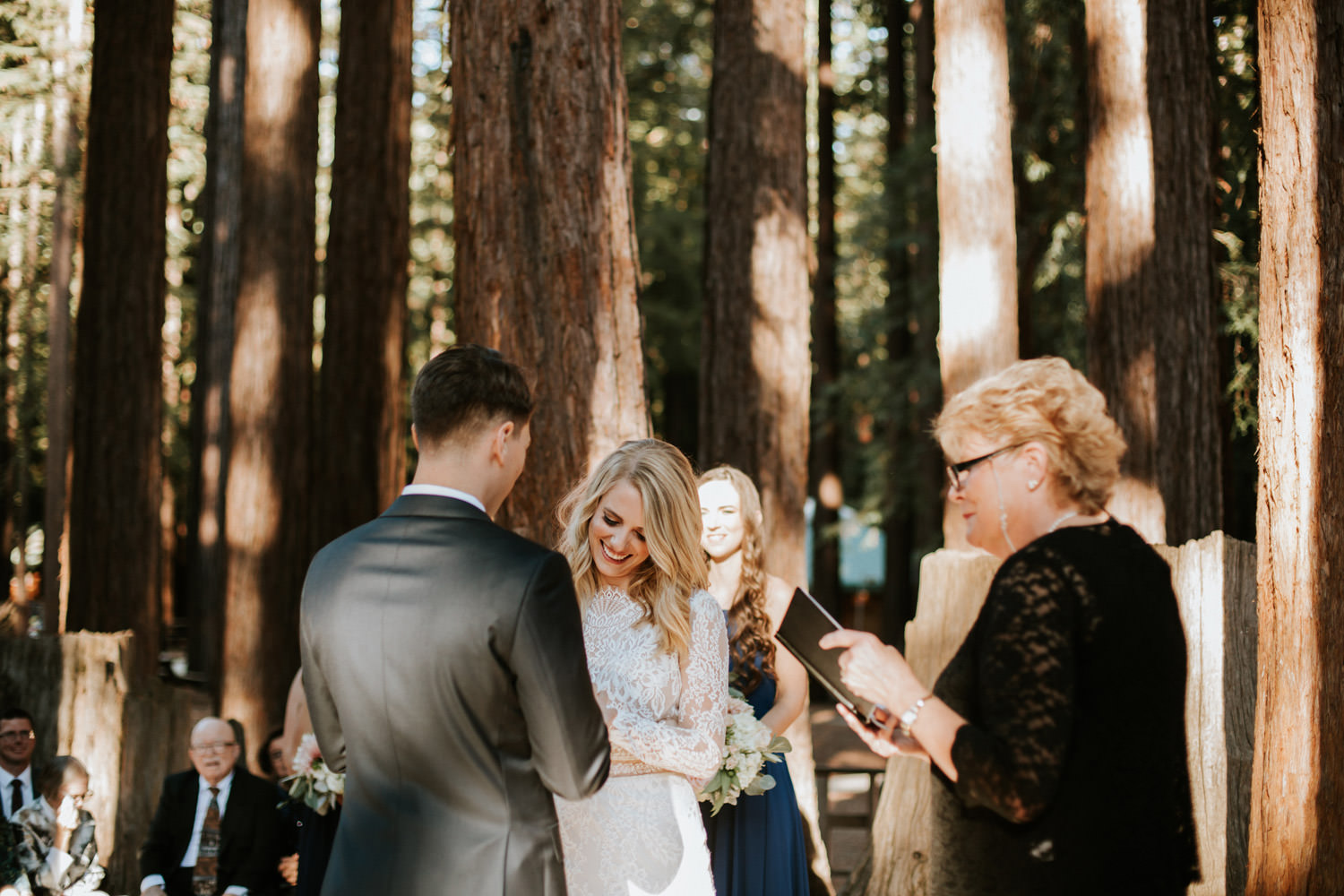 Bride and groom exchange the rings during the ceremony at YMCA Camp Campbell