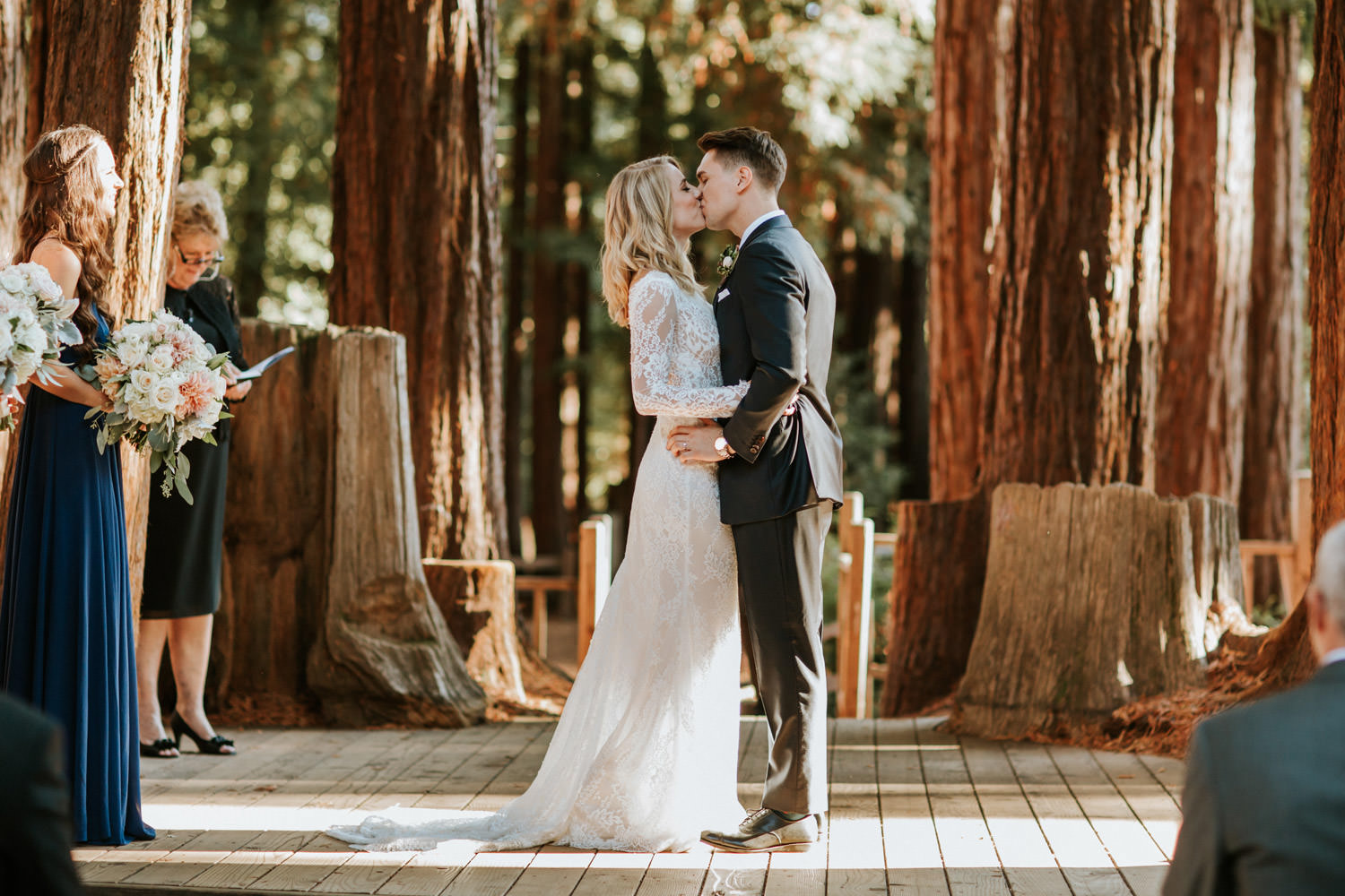 Picture of the first kiss, captured at the wedding at YMCA Camp Campbell