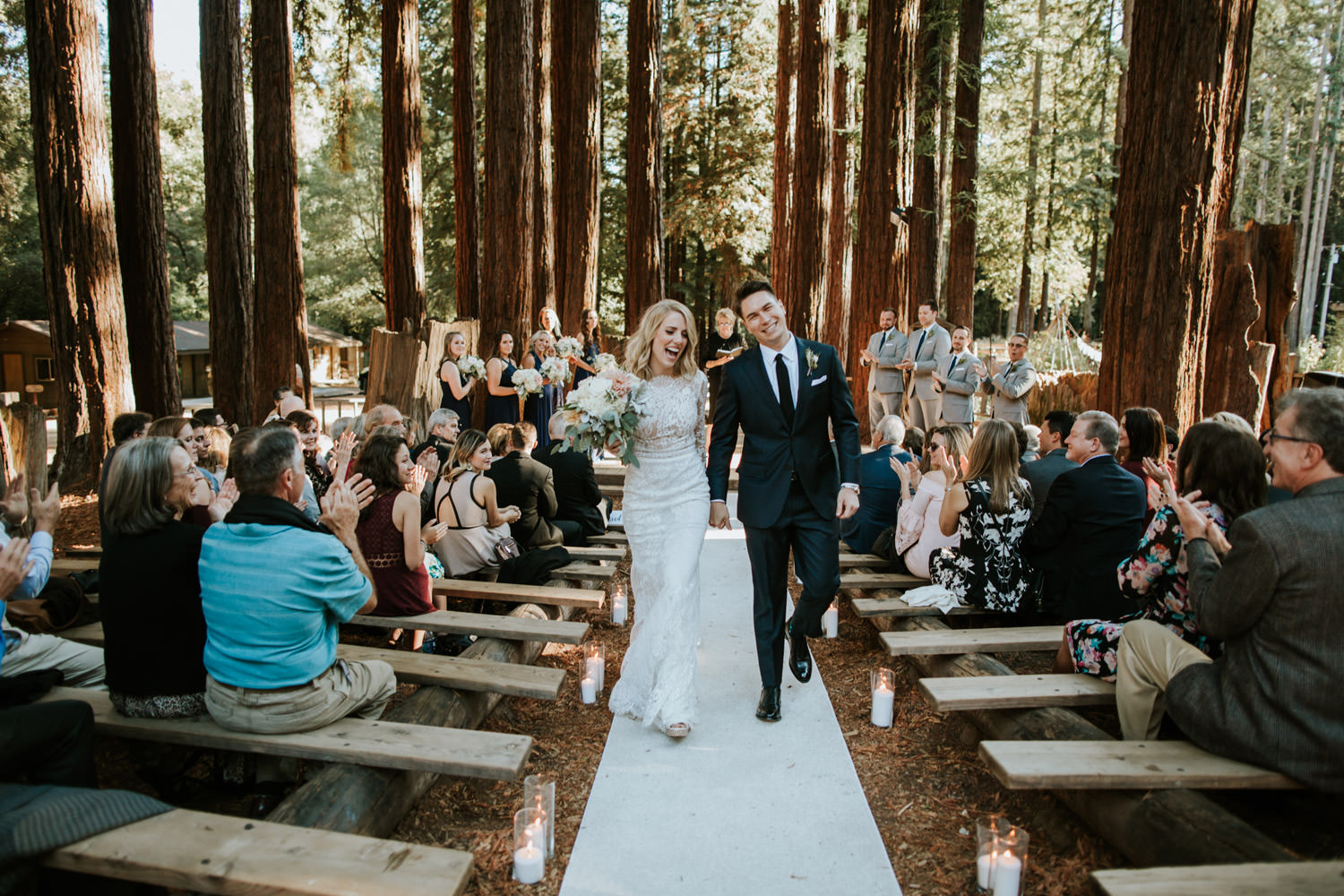 Bride and groom walk down the isle at YMCA Camp Campbell