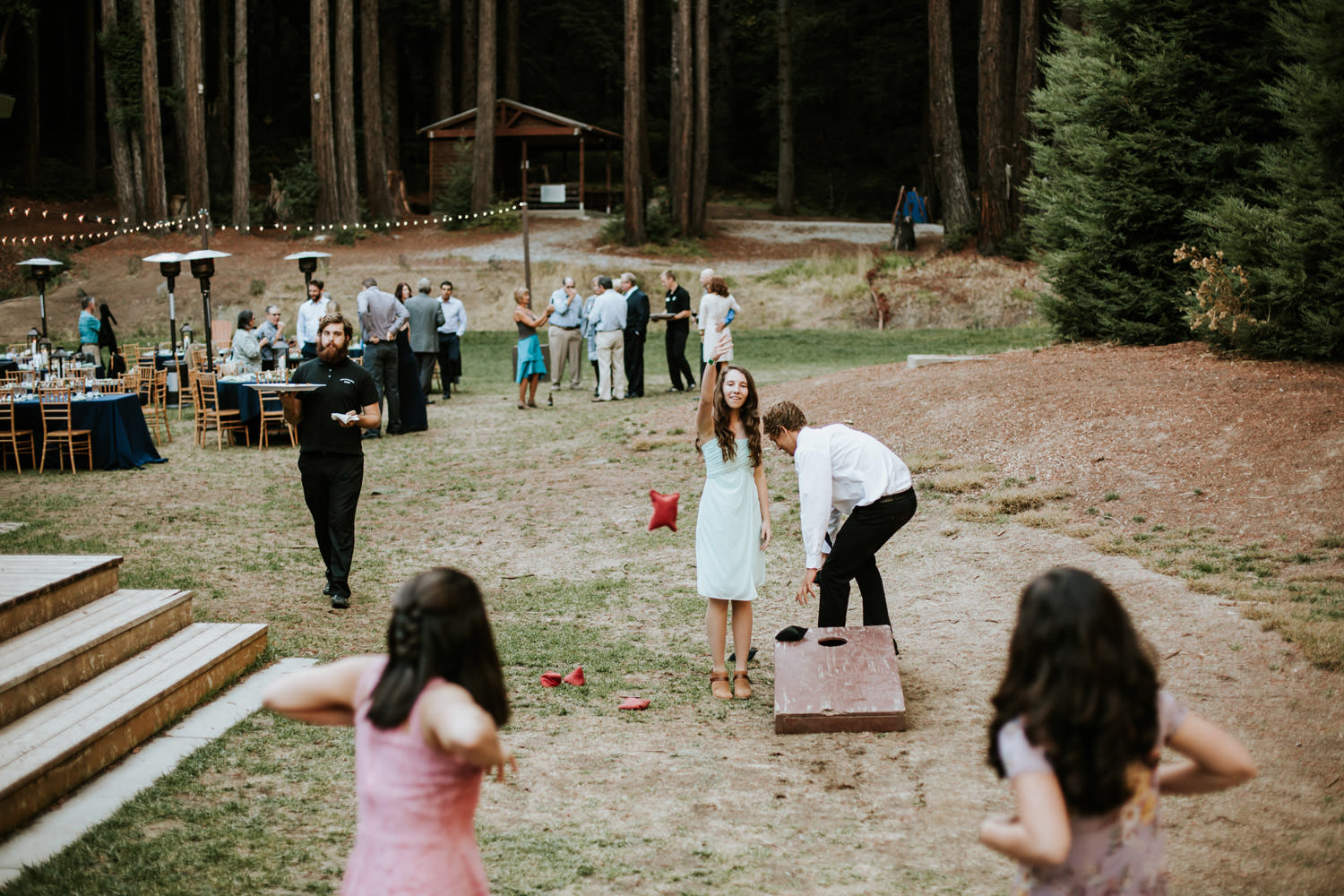 Wedding guest play games during the wedding at Camp Campbell in California