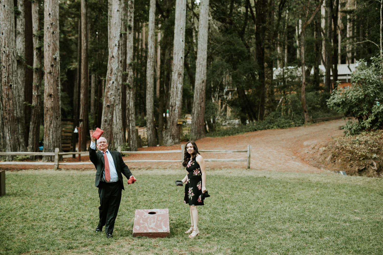 Wedding guest play games during the wedding day in Redwood forest in California