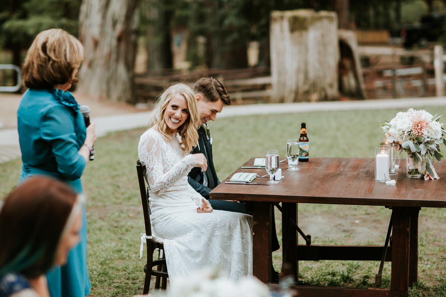 Bride react to her mother speech during the wedding at Camp Campbell in California