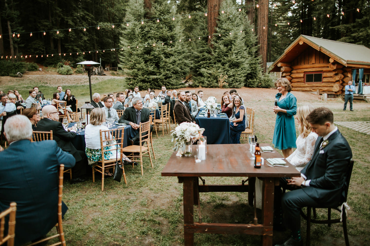 Photograph of the mother of the bride giving the speech during the wedding at Camp Campbell in California