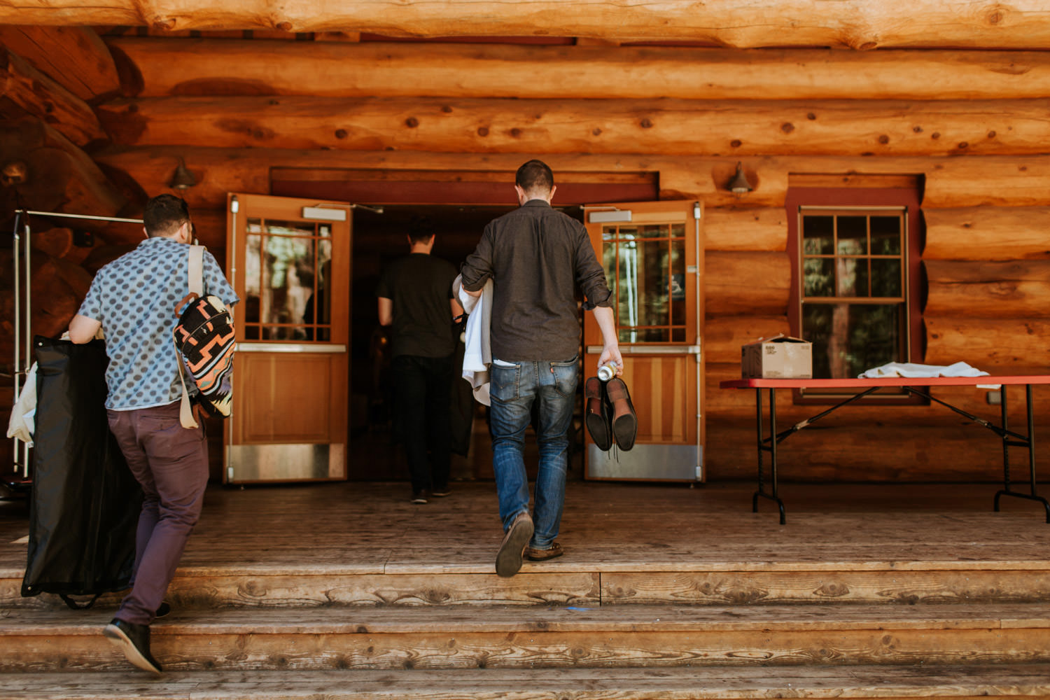 groom walking to the lodge to get dress for the wedding at YMCA Camp Campbell