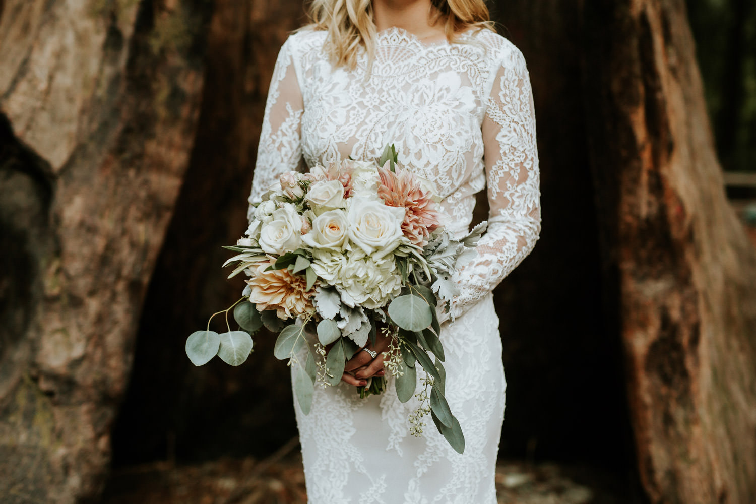 Portrait of the bride taken at Camp Campbell in California. Bride wearing calla blanche dress