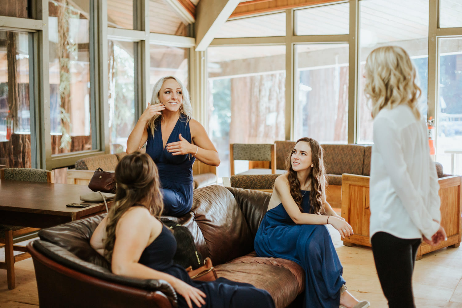 bridemaids talking to the bride before the wedding at YMCA Camp Campball