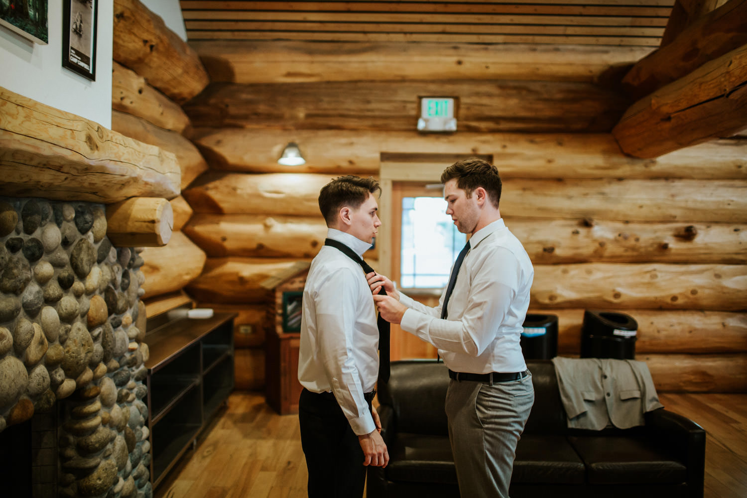 Best man helping the groom with the tie at YMCA Camp Campbell