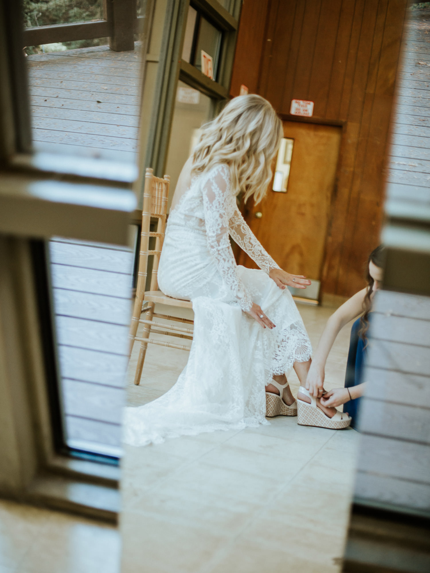 Picture of the Bride putting on her shoes on the wedding day at Camp Campbell in California