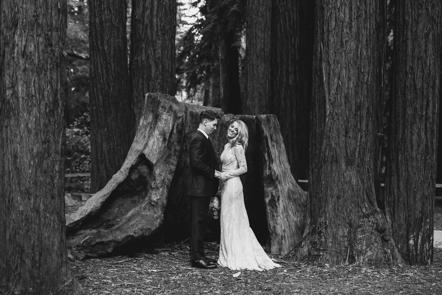 Portrait of the bride taken in California Redwood wearing Calla Blanche