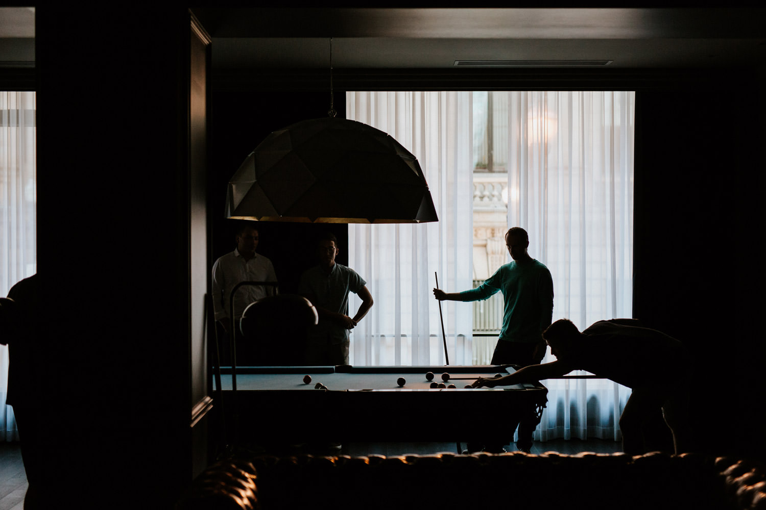 documentary wedding photographer capture the groom getting ready at the gray hotel