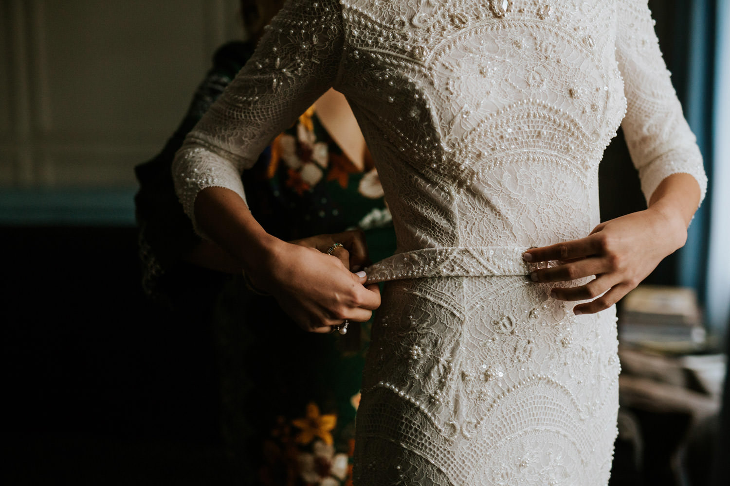 close up pictures of the bride putting on her dress in the gray hotel in chicago