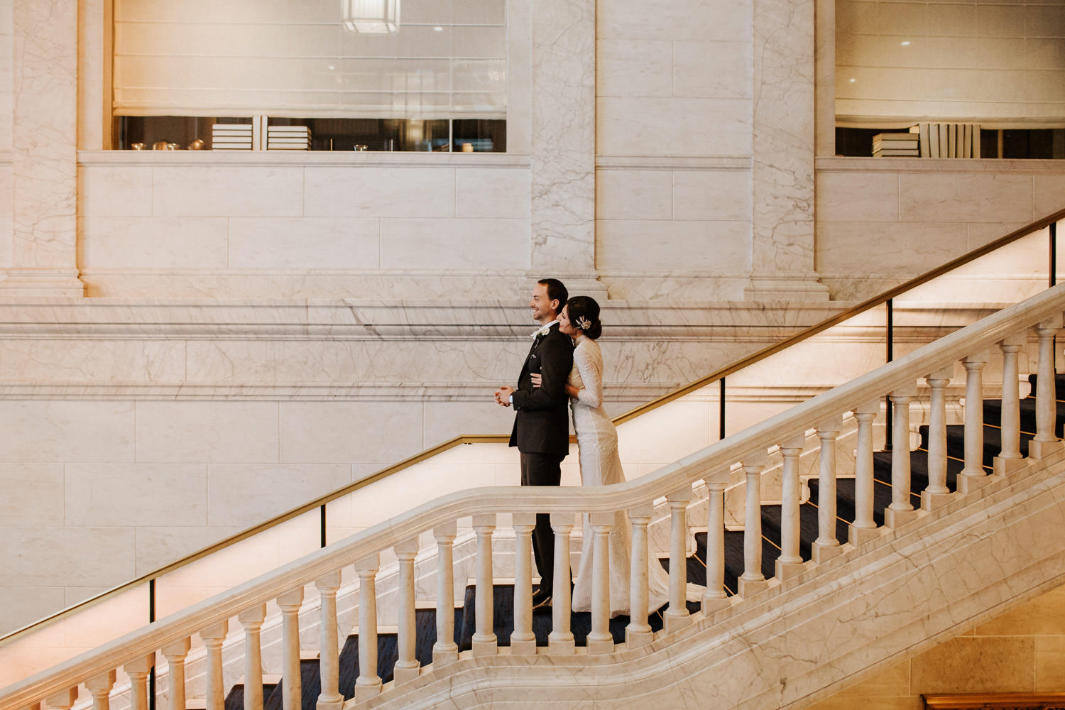first look before the wedding captured on the stairs of the gray hotel in chicago