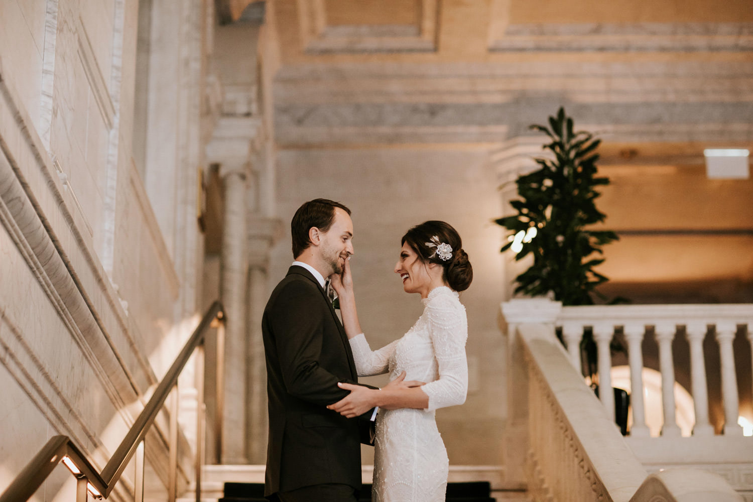 and intimate image of the bride touching the face of the groom during their first look at the gray hotel in chicago