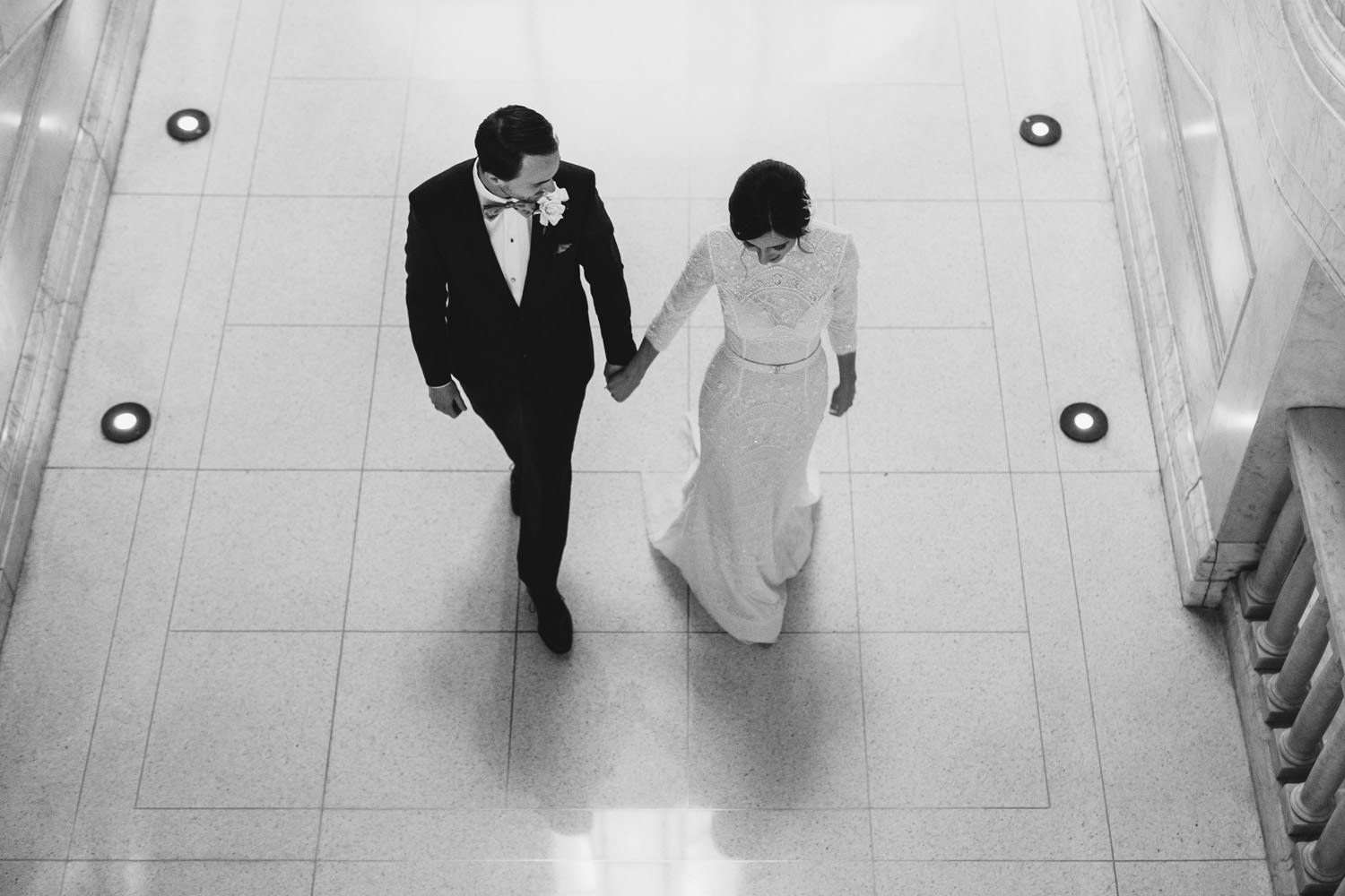 picture of the bride and groom walking inside the gray hotel in chicago