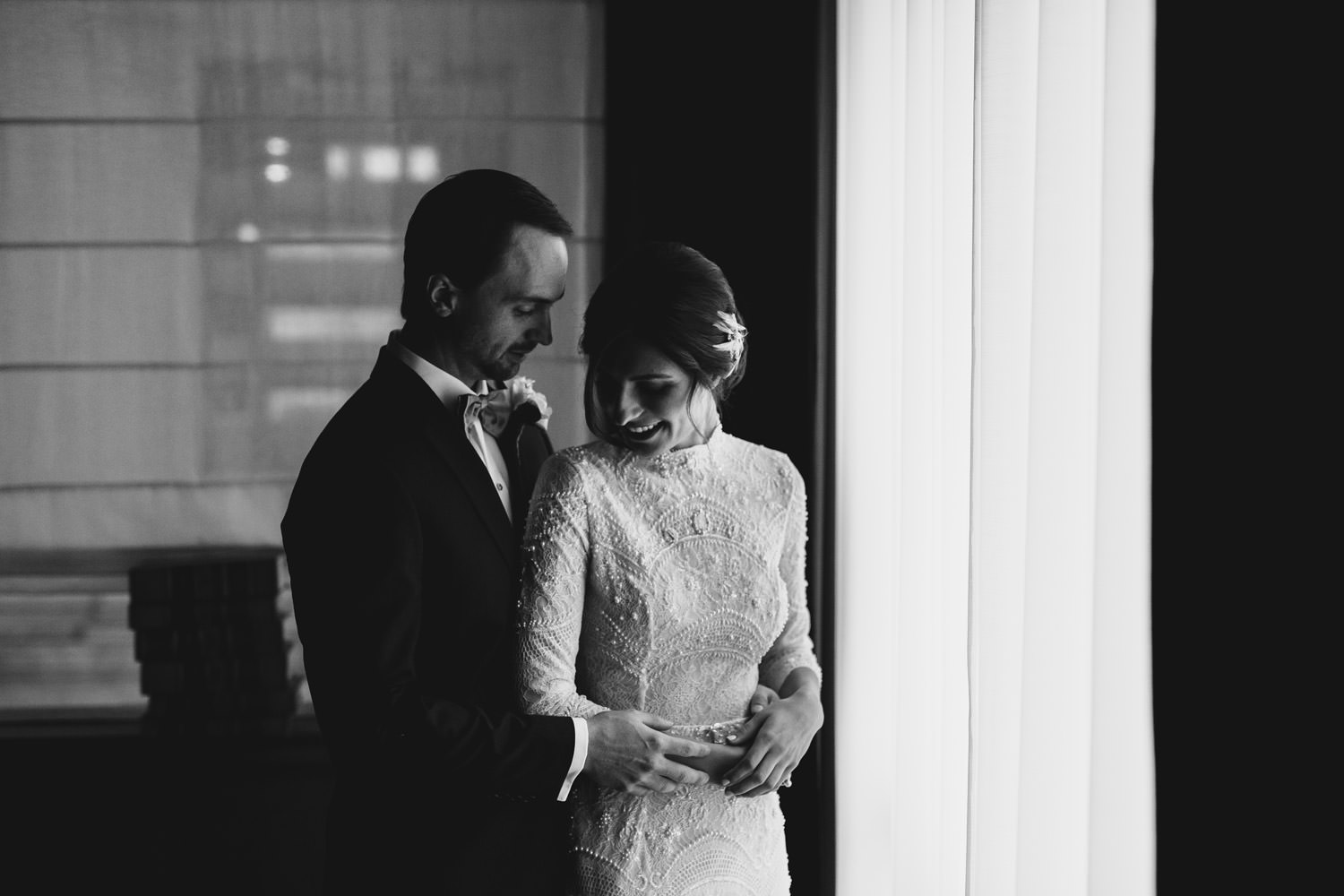 moody black and white portrait of the bride and groom taken at the gray hotel in Chicago
