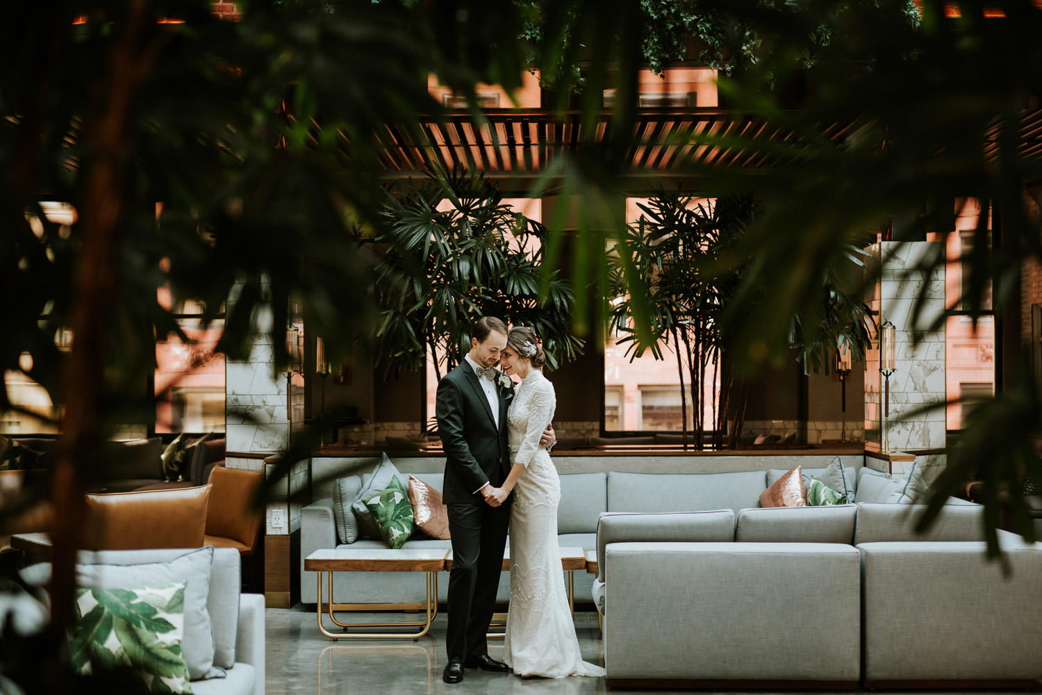 wedding portrait of the bride and groom taken inside the Kimpton Gray hotel on their wedding day