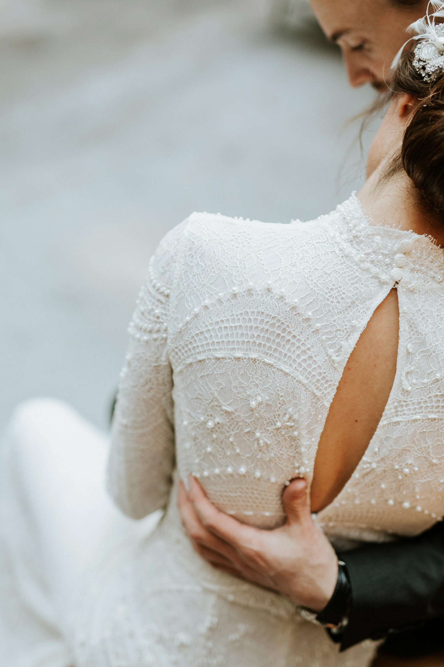 artistic close up photograph of the detail of bride's dress