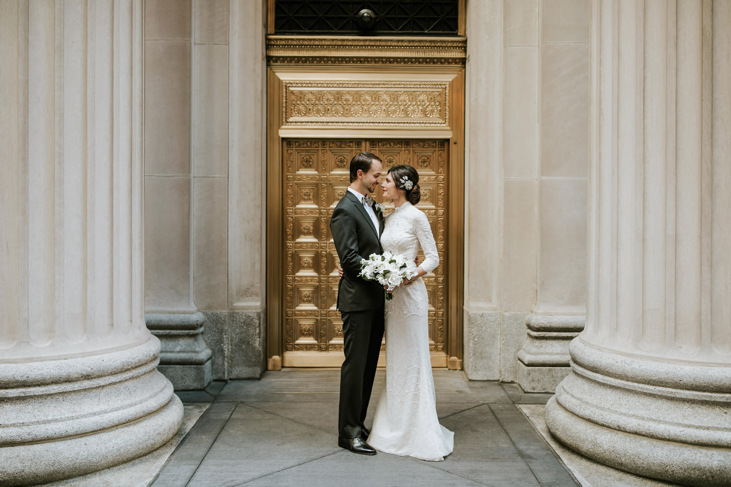 Artistic portrait of the bride and groom taken on their wedding day around Chicago Board of Trade