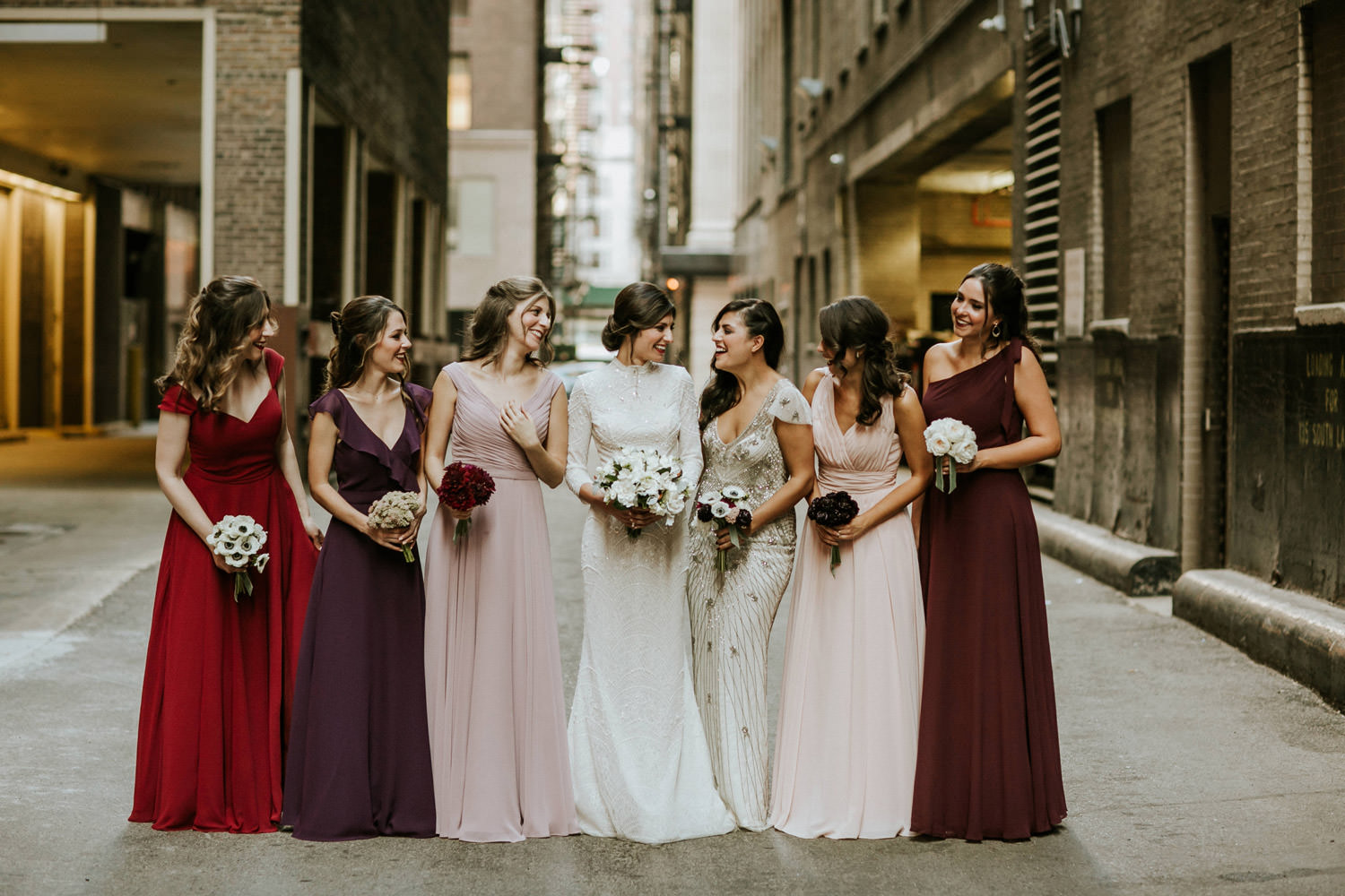 Picture of bride and bridesmaids, wearing colorful dresses, taken by Gray Hotel in Chicago