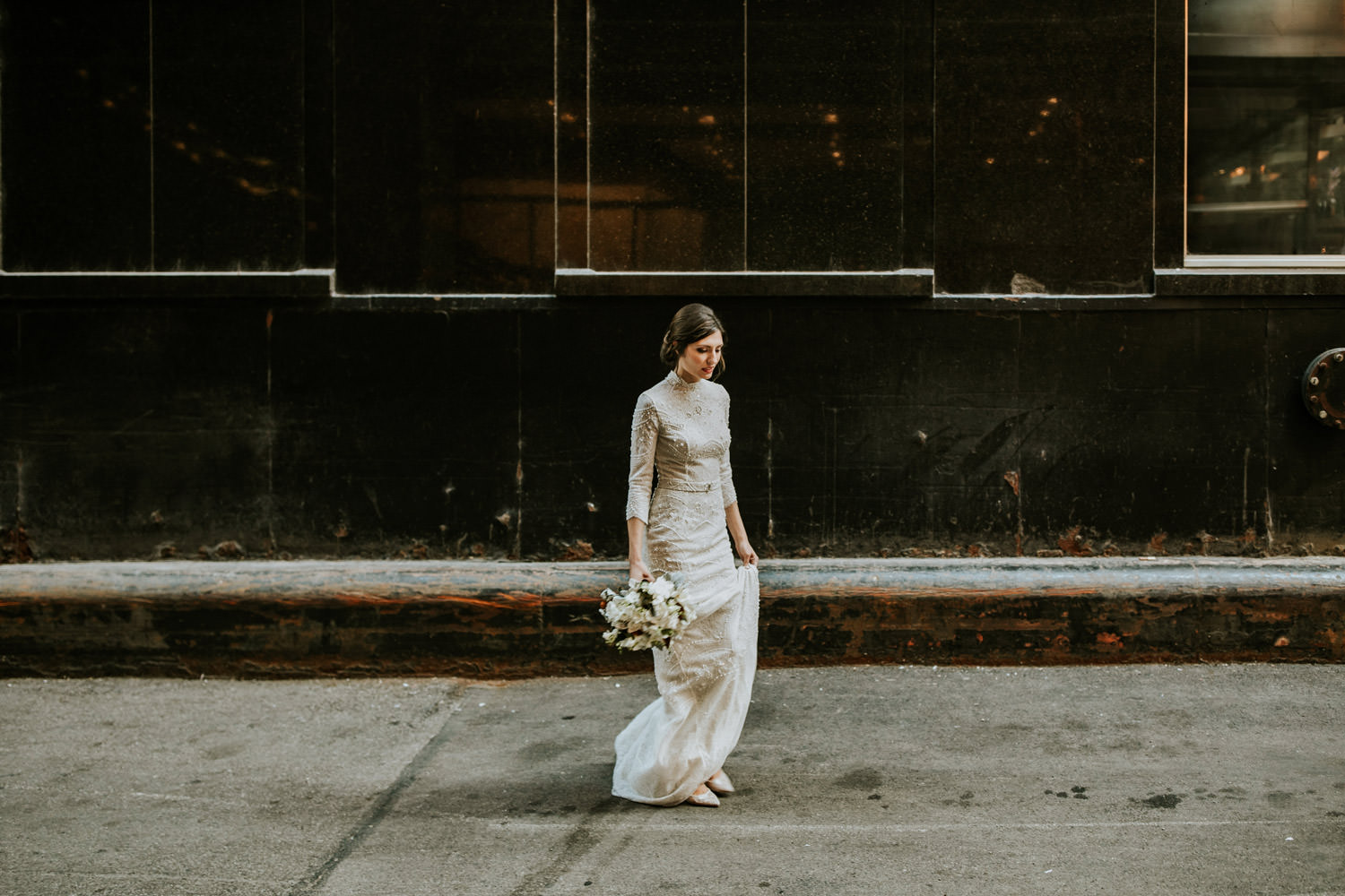 Bride walking outside of the Hotel Gray in Chicago on her wedding day