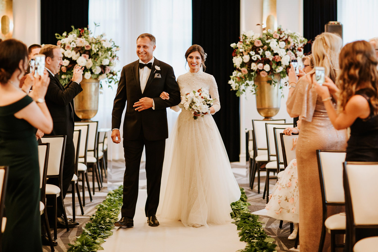 Bride walking down the isle with her father during the wedding dauy at Gray Hotel in Chicago