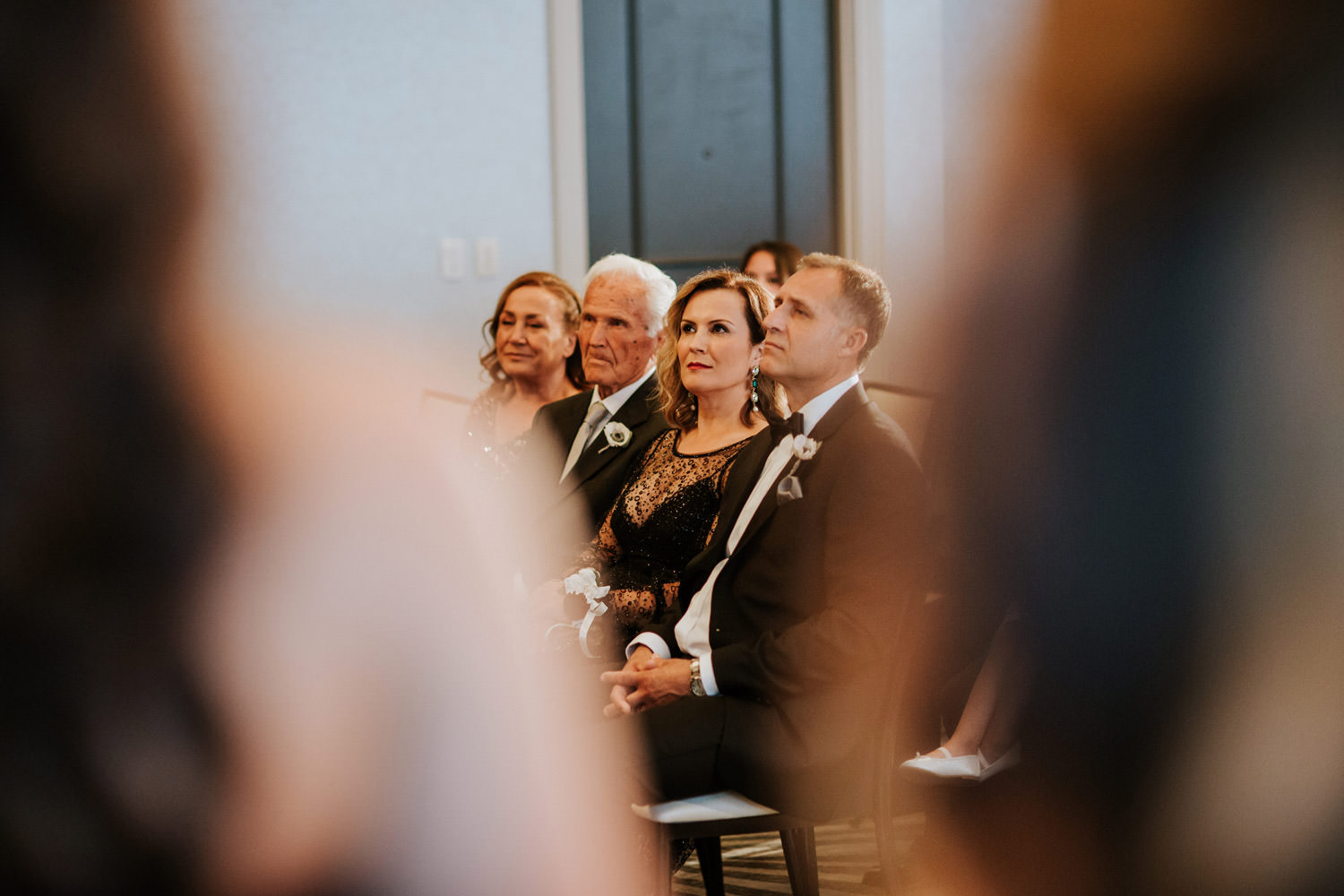 Parents of the bride looking at their daughter during the wedding ceremony at Hotel Gray in Chicago