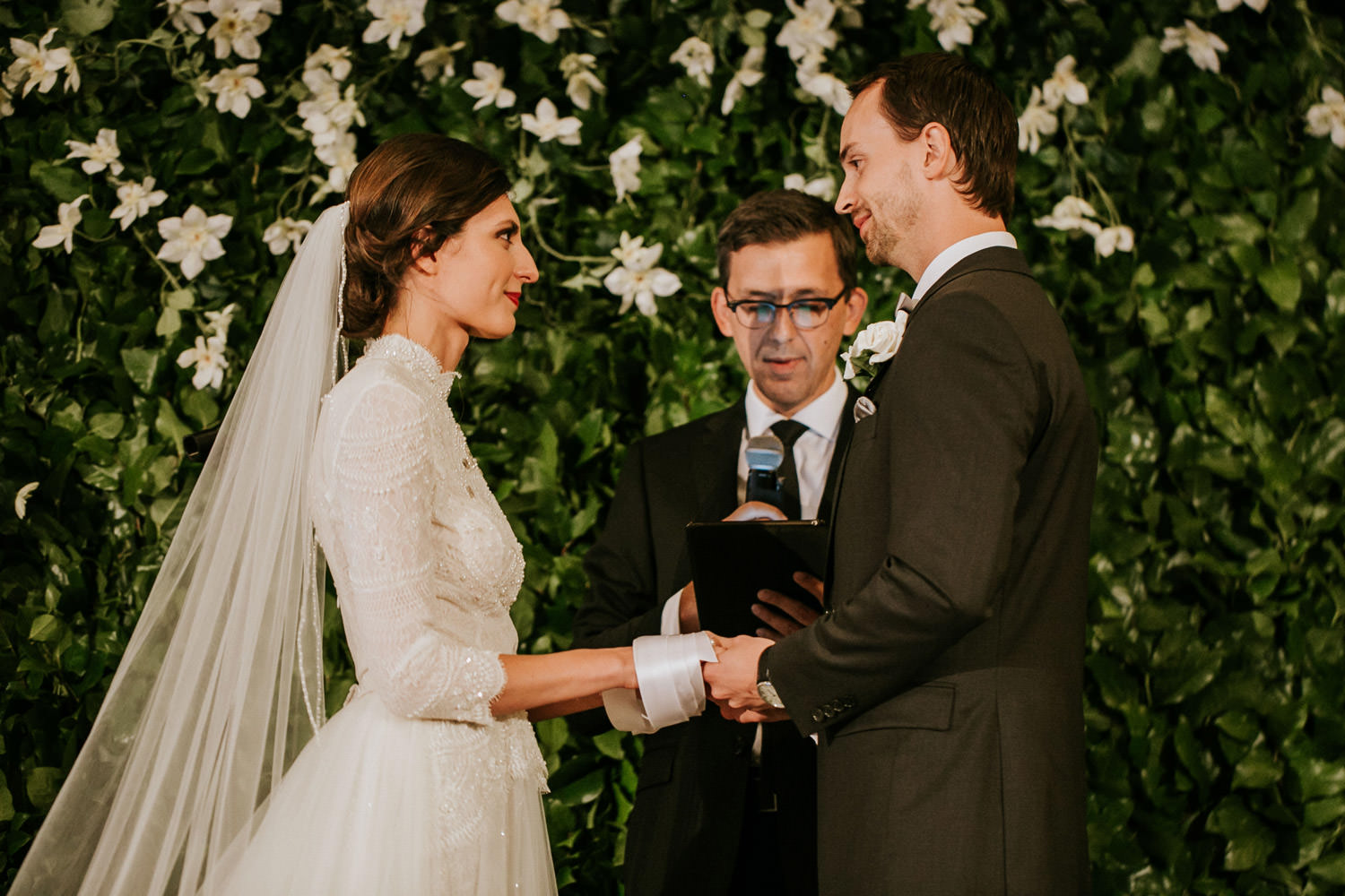 Bride and groom exchange rings during the ceremony at hotel gray in Chicago