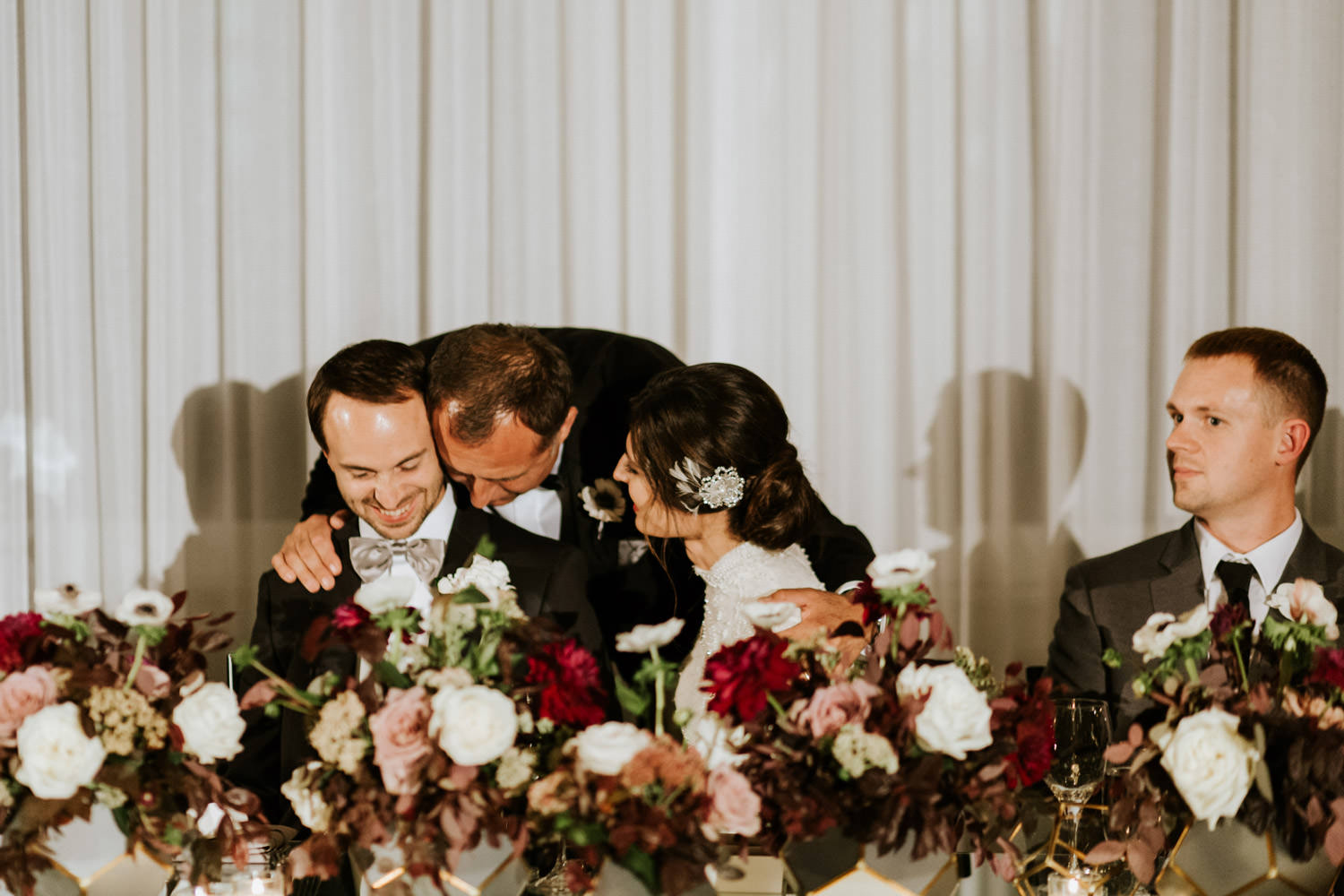 father of the bride kissing her daughter during the wedding at hotel gray