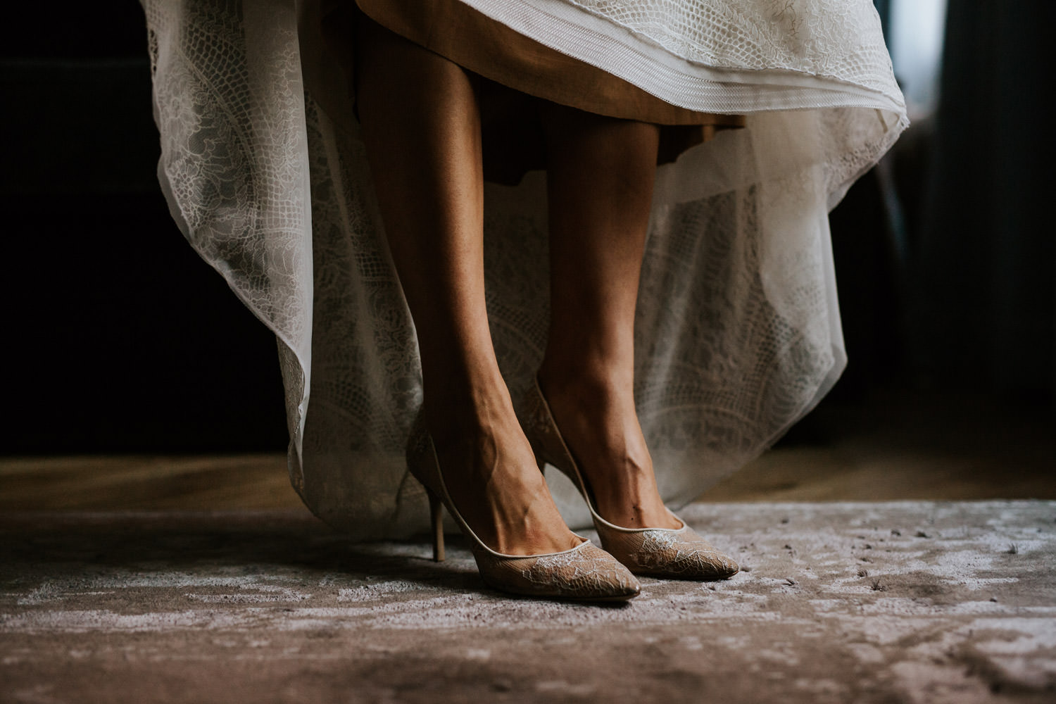 photograph of the bride putting on her wedding shoes at the gray hotel in chicago