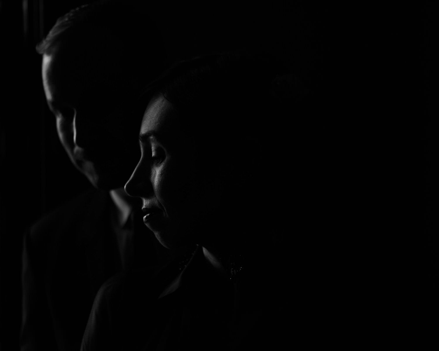 Moody black and white portrait of the bride and groom taken at Maxwell Mansion in Lake geneva