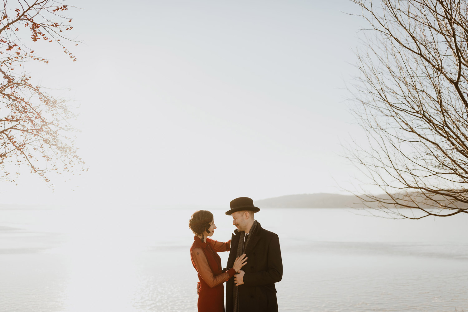 Intimate moment between bride and groom captured by Lake Geneva on their wedding day